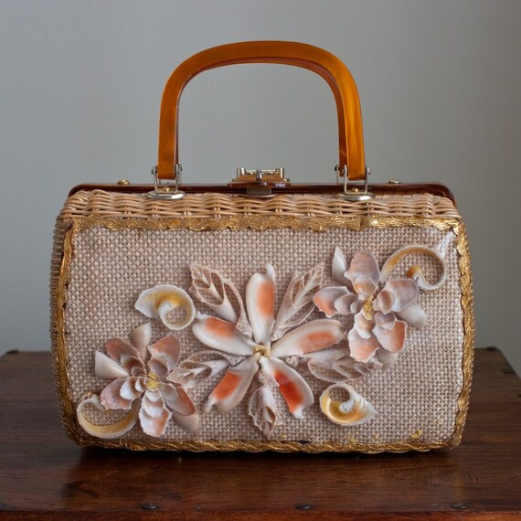 Vintage 1960s Wicker Coated Sea Shell Resort Basket Handbag with a Toffee Marbleized Acrylic Handle. By Adele of Miami
