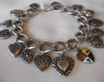 On Sale Circa 1920 Sterling Silver Heart Charm Bracelet