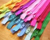 Fifteen 12 Inch YKK zippers to match your bright and light designer fabrics