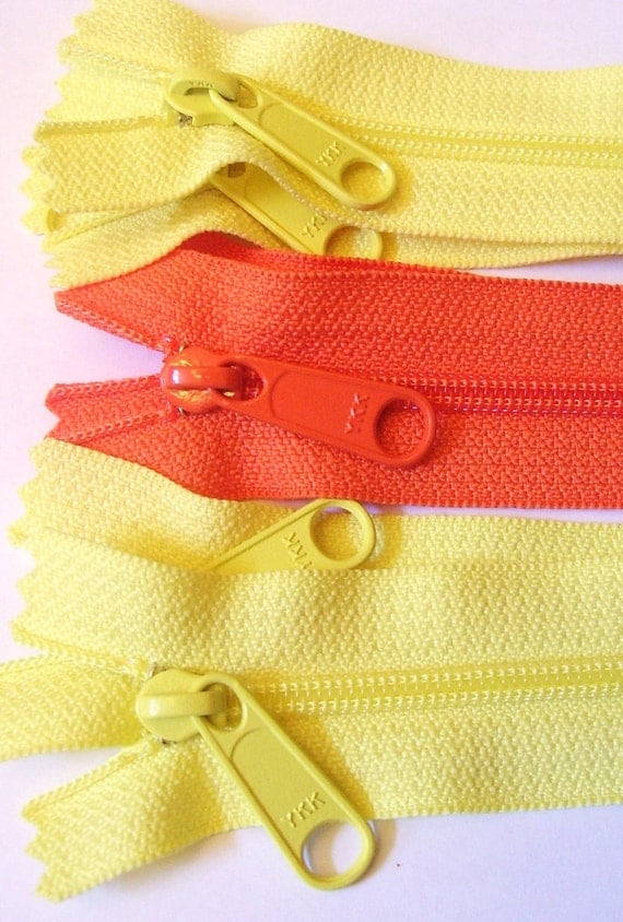 Seven yellow and orange 9 inch YKK Hand bag zippers with extra long pull