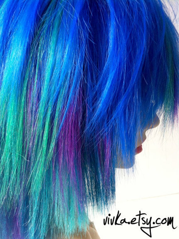the P E A C O C K Synthetic and Human Hair Blend WIG in blue purple green teal peacock