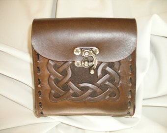 Hand carved leather belt bag