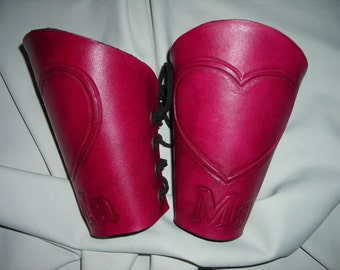 Heart design leather bracers, leather cuffs, wrist guards.