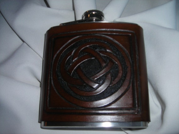 Flask wrapped leather with hand carved celtic knot