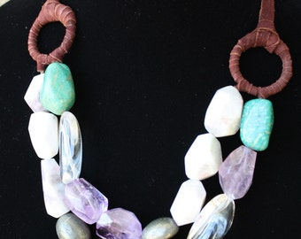 Double-layer chunky bib-necklace with leather details