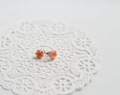 She wore her petite peach earrings