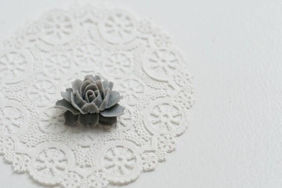Her favorite pale gray brooch