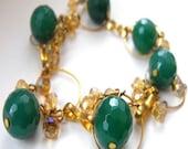 Emerald Green crystal on golden hoops bracelet