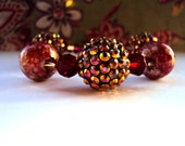 Ruby Red , Gold and Brown Beaded Bracelet with Swarovski Crystal beads and Enamel beads with irridescent tones and gold.