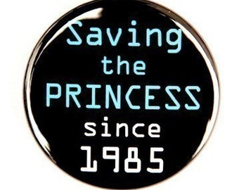 Saving The Princess Since 1985 - Pinback Button Badge 1 1/2 inch 1.5 - Flatback Magnet or Keychain
