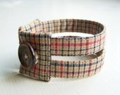 Fabric cuff bracelet in warm autumn plaid