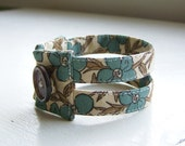 Fabric cuff bracelet in boho blooms beige blue floral