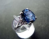 12x10mm 6 carat London Blue Topaz set in an Antique styled Floral Sterling Silver Ring