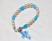 Bracelet faux pearl with blue glass cross