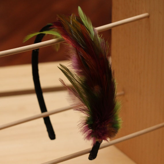 Green purple and brown feather hair band. Fascinator. Comfortable. Flexible. Black ribbon band. Dark and saturated 0121