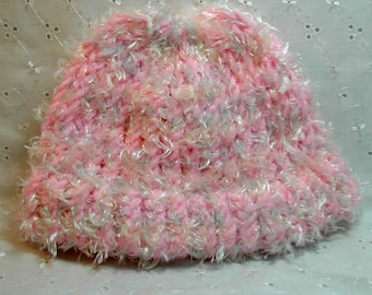 Knitted baby cap in fuzzy pink