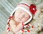 Newborn size tan beanie with red stripe and flower