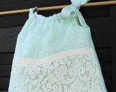 Baby girl's pastel green vintage linen and lace dress