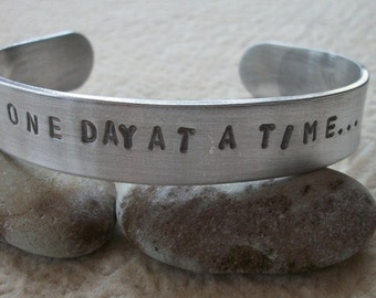One Day At A Time - Hand Stamped Half Inch Aluminum Cuff Bracelet
