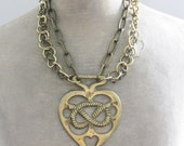 RESERVED knotted heart neckplate