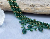 Green beadwoven necklace, forest green and gold with leaf dangles.