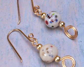 White and multi colored spotty bead earrings, gold plated earwires.