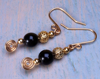 Black and gold earrings dangly earrings black glass beads gold plate filigree and gold plated ear wires.