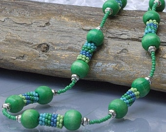 Green necklace with green, blue and yellow hand crafted beadwoven tube beads, unique jewellery, colourful gift idea, Black Friday sale.