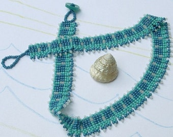 Blue white and turquoise beadwoven necklace.