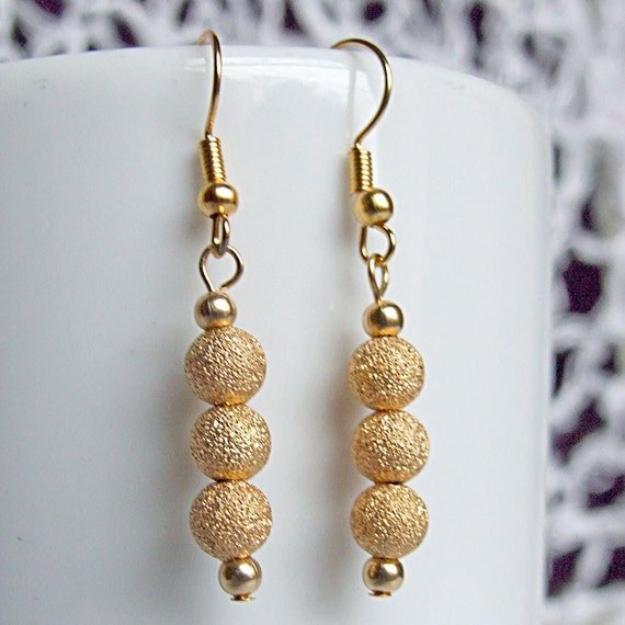 Gold stardust earrings, sparkly dangle earrings with gold plated wires.
