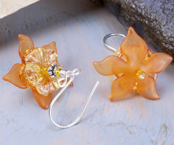 Orange flower earrings, yellow and orange lucite flowers on silver plated ear wires.