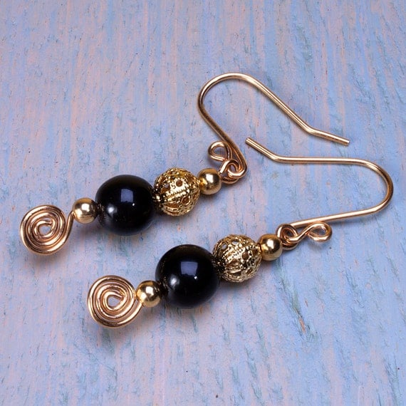 Black and gold earrings dangly earrings black glass beads gold plate filigree and gold plate ear wires.
