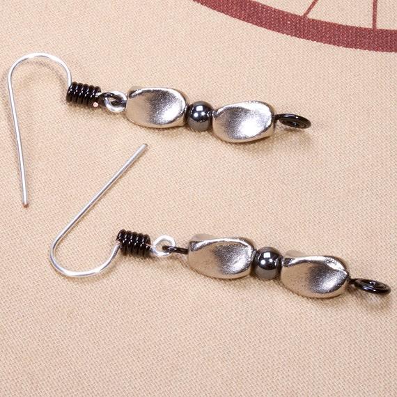 Black and silver swirl drop earrings, hematite with Tibetan silver.