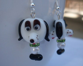 Cute White Dogs with Sparkling Green Collar