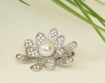 Silver plated metal rhinestone flower brooch with pearl accent