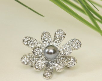 Silver plated metal rhinestone flower brooch with gray colored pearl accent