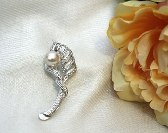 Silver metal swirl leaf brooch with pearl accent center