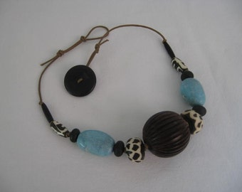 Chunky Wood, Turquoise, Bone and Fiber Necklace.