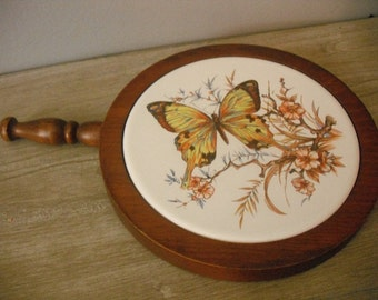 beautiful vintage Butterfly and apple or cherry  blossom trivet .. wood and painted tile .. Handled