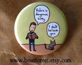 hubris is dangerous, kitty - pinback button badge