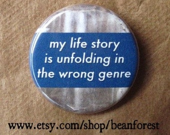 my life story is unfolding in the wrong genre - pinback button badge