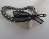 A true lady - moss pearls and black negligee bow bracelet