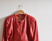 1980s red leather jacket with golden studs