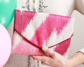 Hot pink zigzag Lolie envelope clutch