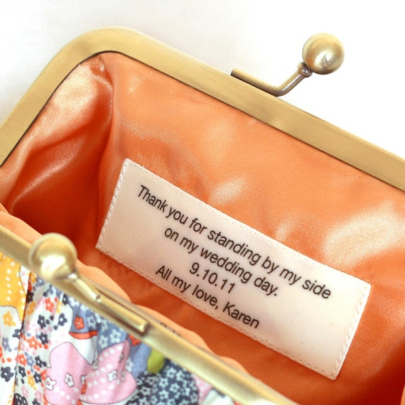 Custom message on a wide satin ribbon for your clutch