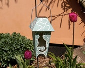 Green Cat Design.  Solar Powered Lantern.