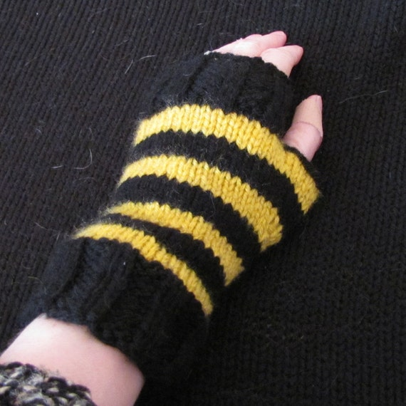 Fingerless mittens in Hufflepuff colors by Whitaker Knits.
