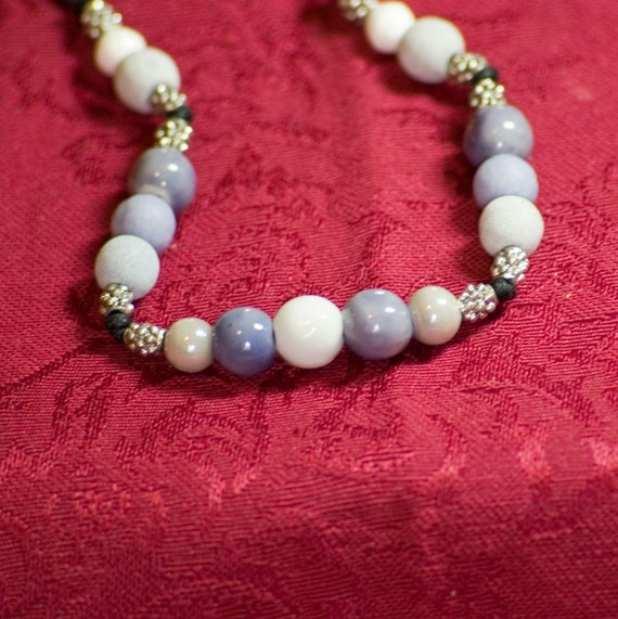 Shades of lilac ceramic bead and knotted cord necklace