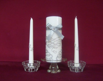 Unity candle, pillar candle, silver twirls, ribbons and bows, tapers to match