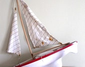 It floats. French antique toy sailboat. 1960s.